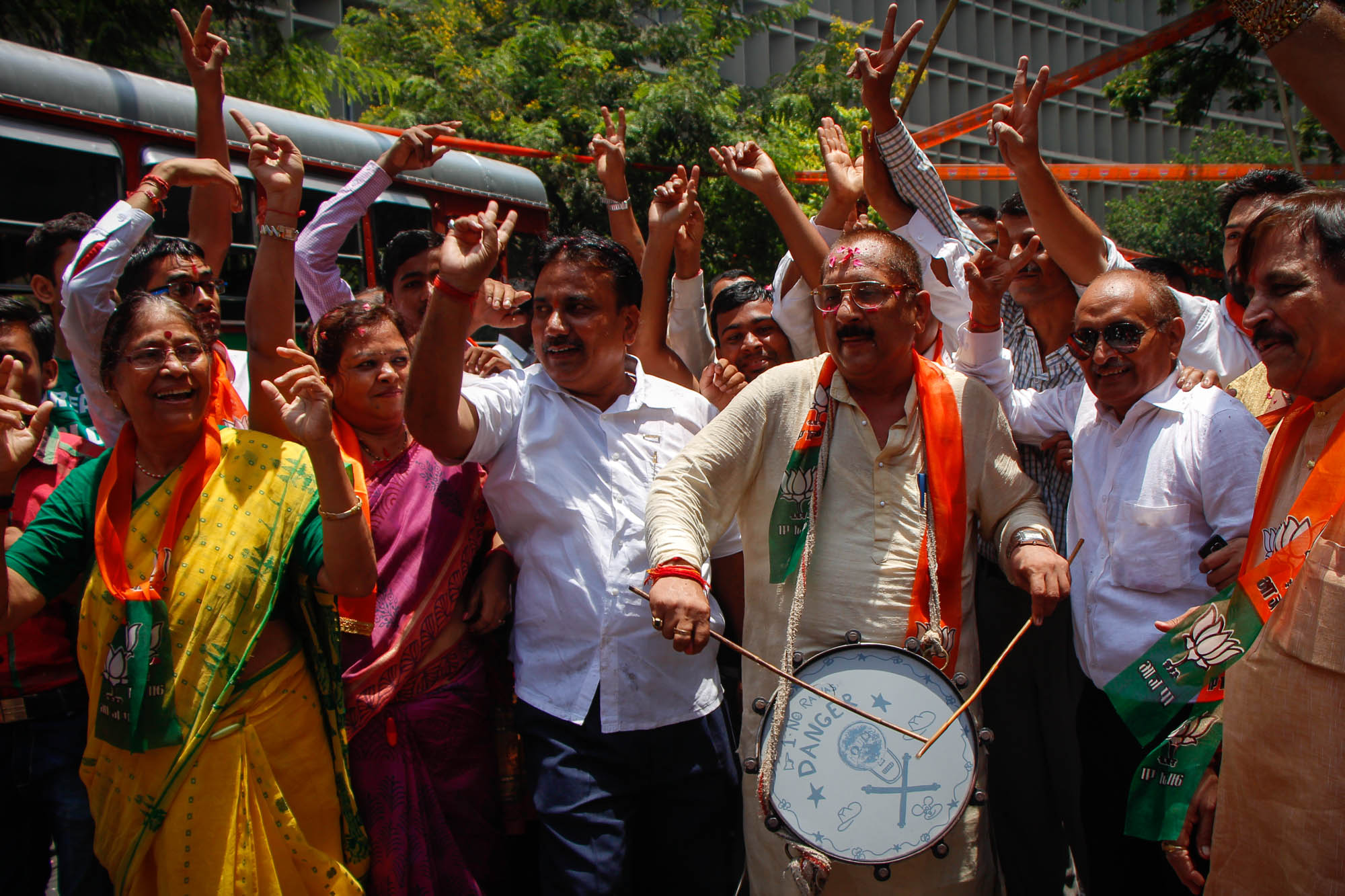'   Bharatiya Janata Party supporters celebrate outside the BJP office in Mumbai on 16th May 2014 after the party is set to win 281 seats on its own, nine more than the majority mark - which means that it could have formed government even without its pre-poll allies.   Sumedh Sawant / Indus Images'